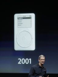 Apple CEO Tim Cook talk about iPod during announcement at Apple headquarters in Cupertino, Calif., Tuesday, Oct. 4, 2011. (AP Photo/Paul Sakuma)