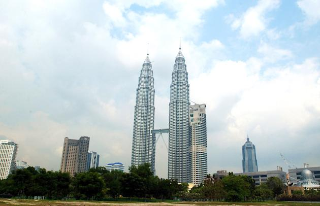 402362 09: The 88-story Petronas Twin Towers, the tallest buildings in the world, soar March 12, 2002 in downtown Kuala Lumpur, Malaysia. The gleaming architectural towers, inspired by the Five Pillars of Islam, are the centerpiece of the ultra-modern Kuala Lumpur City Center (KLCC). In an age of ethnic strife, poverty, and civil war, Malaysians have managed to forge a peaceful and prosperous multiethnic society. (Photo by Chris Hondros/Getty Images)