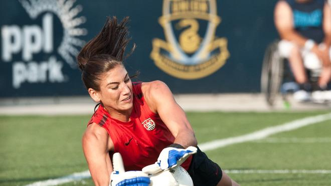 US Women's National Football Team Goalkeeper Hope Solo Warms AFP/Getty Images