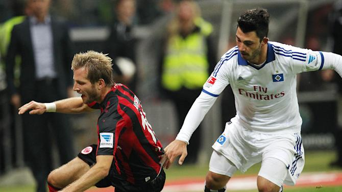 Frankfurt's Stefan Aigner, left, and Hamburg's Hakan Calhanoglu of Turkey challenge for the ball during a German soccer Bundesliga match between Eintracht Frankfurt and Hamburger SV in Frankfurt, Germany, Saturday, Sept.28, 2013