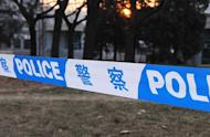 This file illustration photo shows police tape cordoning off an area in Beijing. A Chinese man has been arrested on suspicion of killing two nightclub hostesses and keeping another four women as sex slaves in a basement dungeon, according to police