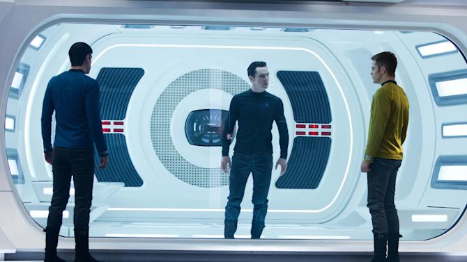 """FILE - This undated publicity film image released by Paramount Pictures shows, from left, Zachary Quinto, as Spock, Benedict Cumberbatch as John Harrison, and Chris Pine as Kirk, in a scene in the film, """"Star Trek Into Darkness,"""" from Paramount Pictures and Skydance Productions. """"Star Trek Into Darkness"""" was one of several upcoming films to receive spotlight treatment with an ad that aired during Super Bowl XLVII on Sunday, Feb. 3, 2013. (AP Photo/Paramount Pictures, Zade Rosenthal, File)"""