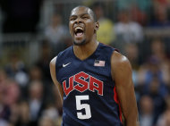 USA's Kevin Durant reacts after hitting a three point basket during a preliminary men's basketball game against Argentina at the 2012 Summer Olympics, Monday, Aug. 6, 2012, in London. (AP Photo/Eric Gay)
