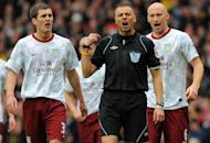 Aston Villa's English midfielder Gary Gardner (L) and Aston Villa's Welsh defender James Collins (R) argue with referee Mark Halsey after conceeding a penalty during the English Premier League football match between Manchester United and Aston Villa at Old Trafford in Manchester. United won 4-0