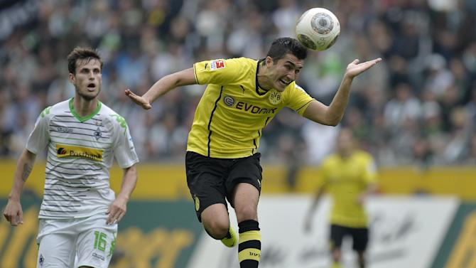 Dortmund's Nuri Sahin of Turkey, right, heads the ball in front of Moenchengladbach's Havard Nordtveit of Norway during the German first division Bundesliga soccer match between Borussia Moenchengladbach and Borussia Dortmund in Moenchengladbach, Germany, Saturday, Oct. 5, 2013