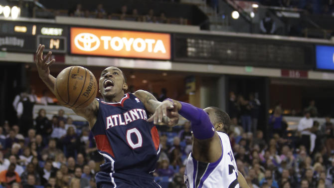 Atlanta Hawks guard Jeff Teague, left, is fouled by Sacramento Kings guard Marcus Thornton during the first quarter of an NBA basketball game in Sacramento, Calif., Tuesday, Nov. 5, 2013