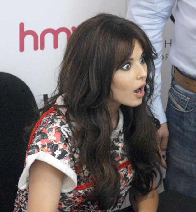 Celebrity photos: Cheryl Cole pulled her best omg! face at an album signing back in her native Newcastle this week. We love it.