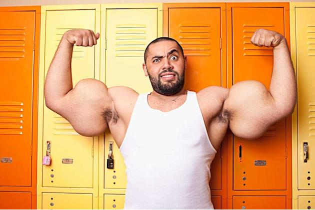 This real life Popeye set the record for the world's biggest arms, measuring 31in each. Moustafa Ismail, from Egypt, denies any use of steroids, shuns spinach and works out everyday in a suburb in