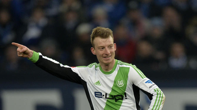 Wolfsburg's Maximilian Arnold celebrates his goal during the German Bundesliga soccer match between FC Schalke 04 and VfL Wolfsburg in Gelsenkirchen,  Germany, Saturday, Feb. 1, 2014
