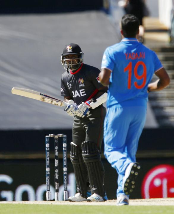 UAE's batsman Krishna Karate looks at India's bowler Umesh Yadav after he avoided a bouncer delivered by Yadav during their Cricket World Cup match in Perth