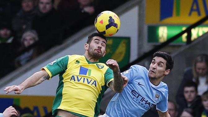 Norwich City's Johnson challenges Manchester City's Jovetic during their English Premier League soccer match at Carrow Road in Norwich, eastern England
