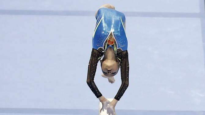 China's Shang competes in the women's beam final round at the Gymnastics World Challenge Brazil in Sao Paulo