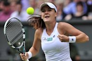 Poland's Agnieszka Radwanska celebrates her women's singles semi-final victory over Germany's Angelique Kerber on day 10 of the 2012 Wimbledon Championships tennis tournament at the All England Tennis Club in Wimbledon, on July 5. Radwanska won 6-3, 6-4