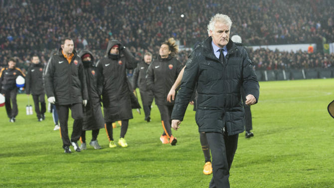 PSV head coach Fred Tutten leaves the pitch after Referee Clement Cano from France ceased  an Europa  League round of 32 second leg soccer match between Feyenoord and AS Roma, at De Kuip stadium in Rotterdam, Netherlands, Thursday Feb. 26, 2015. (AP Photo/Ermindo Armino)