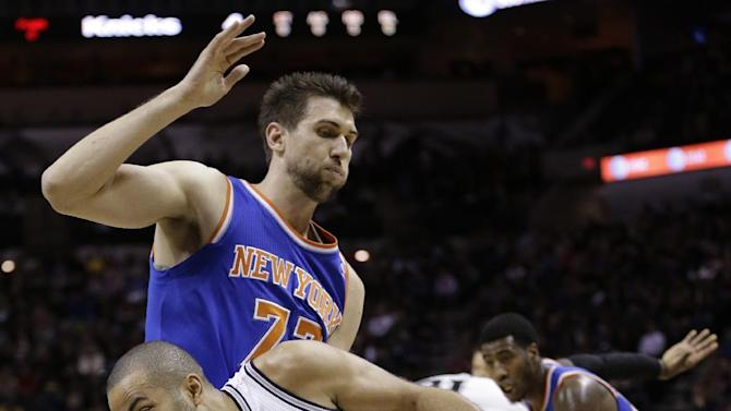 San Antonio Spurs' Tony Parker (9) drives around New York Knicks' Andrea Bargnani during the first half on an NBA basketball game, Thursday, Jan. 2, 2014, in San Antonio