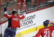 Washington Capitals left wing Alex Ovechkin, left, of Russia, celebrates his goal with teammate Brooks Laich (21) during the first period of an NHL hockey game against the Buffalo Sabres, Friday, Dec. 30, 2011, in Washington. (AP Photo/Nick Wass)