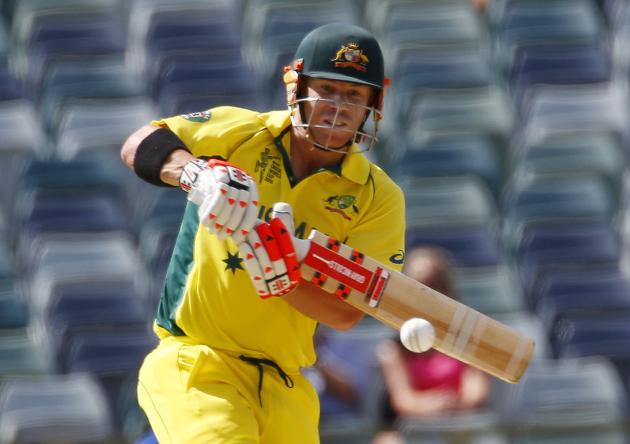 Australia's batsman David Warner hooks the ball against Afghanistan during their Cricket World Cup match in Perth