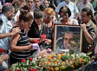 Ofelia Acevedo (L) widow of Cuban political activist Oswaldo Paya and their daughter Rosa Maria Paya (2nd-L) attend his funeral, on July 24, at Cristobal Colon cemetery in Havana. Cuban police arrested dozens of dissidents at the funeral, after his daughter's vow to seek justice over his sudden death in a road accident