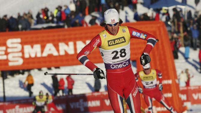 Mikko Kokslien of Norway crosses the finish line to come in third-placed in the cross country race during the FIS Nordic Combined World Cup competition in Lillehammer