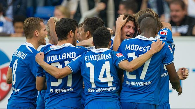 Hoffenheim's players celebrate after scoring during the German first division Bundesliga soccer match between TSG 1899 Hoffenheim and Schalke 04 in Sinsheim, Germany, Saturday, Sept. 28, 2013. The match ended with 3-3