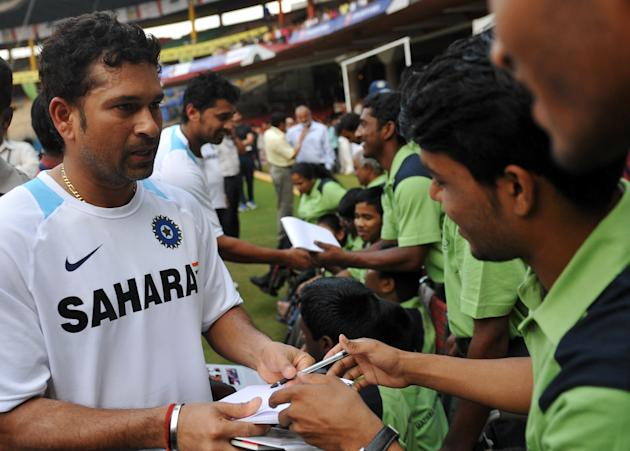 Indian cricketer Sachin Tendulkar signs