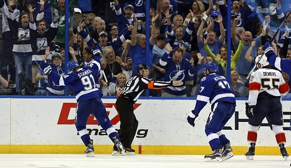 TAMPA, FL - OCTOBER 18: Referee Gord Dwyer #19 signals a goal as Steven Stamkos #91 and Alex Killorn #17 of the Tampa Bay Lightning celebrate as Jason Demers #55 of the Florida Panthers reacts during the third period at the Amalie Arena on October 18, 2016 in Tampa, Florida. (Photo by Mike Carlson/Getty Images)
