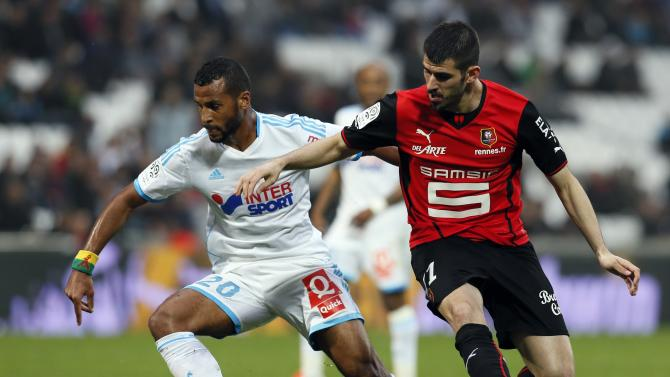 Olympique Marseille's Romao challenges Oliveira of Rennes during their French Ligue 1 soccer match at the Velodrome stadium in Marseille