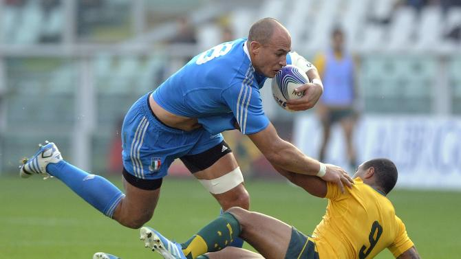 Italy's Sergio Parisse is tackled by Australia's Will Genia during their Six Nations rugby union match at the Olympic stadium in Turin
