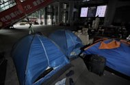 This file photo shows tents and belongings of the anti-capitalist 'Occupy' movement in Hong Kong, on the ground level of the HSBC building, pictured in June. Hong Kong court on Monday approved the eviction of the protesters, in a major blow to one of the last outposts of the 'Occupy' movement in Asia