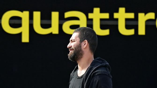 Barcelona's injured soccer player Turan takes part in a commercial event near Camp Nou stadium in Barcelona