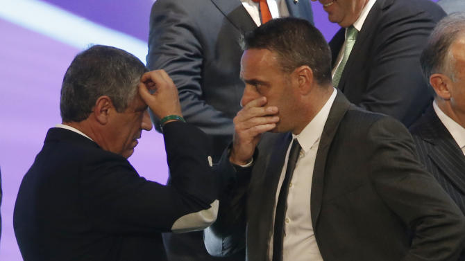 Greece head coach Fernando Santos from Portugal, left, and Portugal head coach Paulo Bento react after the draw ceremony for the 2014 soccer World Cup in Costa do Sauipe near Salvador, Brazil, Friday, Dec. 6, 2013