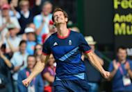 Great Britain's Andy Murray celebrates after winning the men's singles gold medal match of the London 2012 Olympic Games by defeating Switzerland's Roger Federer, at the All England Tennis Club in Wimbledon, southwest London