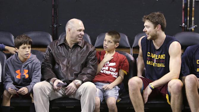 Cleveland Cavaliers rookie guard Matthew Dellavedova, right, of Australia,  talks with his former coach, at Saint Mary's College of California, Randy Bennett before the Cavaliers played the Sacramento Kings  during the first quarter of an NBA basketball game in Sacramento, Calif.,  Sunday, Jan. 12, 2014. Bennett attended the game with his sons Cade, 10, left, and Chase, 11, center