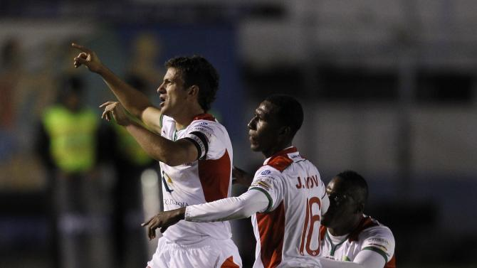 Larrea, Ayovi and Arboleda of Ecuador's LDU de Loja celebrate after Larrea scored against Argentina's River Plate during their Copa Sudamericana soccer match at Reina del Cisne stadium in Loja