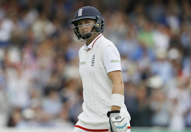 England's Joe Root leaves the pitch  after being caught by Trent Boult off the bowling of New Zealand's Matt Henry, during the fourth day of the first Test match between England and New Zealan
