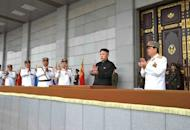 North Korean leader Kim Jong-Un (C) is shown surrounded by military leaders at the plaza of the Kumsusan Palace in Pyongyang, April 25, 2013