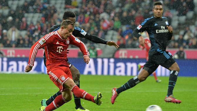 Bayern's Xherdan Shaqiri, left,  of Switzerland scores during  the German first division Bundesliga soccer match between FC Bayern Munich and Hamburger SV  in Munich, Germany, Saturday, Dec. 14, 2013