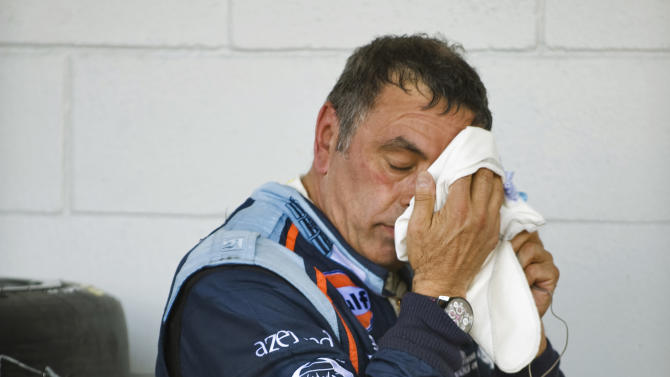 Oak Racing's Frederic Da Roche, of France, wipes his face in pit row after driving during the 59th annual American Le Mans Series 12 Hours of Sebring auto race at the Sebring International Raceway Saturday, March 19, 2011 in Sebring, Fla. (AP Photo/Steve Nesius)