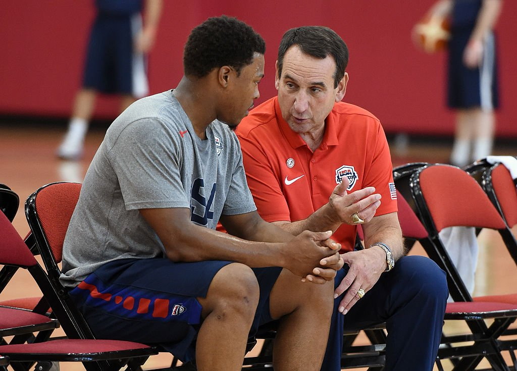 USA Basketball head coach Mike Krzyzewski (right) talks with guard Kyle Lowry during practice on July 21, 2016 in Las Vegas, Nevada. (Ethan Miller/Getty Images)