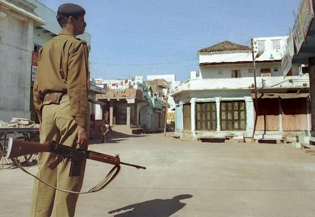 A Indian policeman patrols Ganjbasoda in Madhya Pradesh state on January 15, 2003. A Swiss female tourist was gang-raped in Madhya Pradesh -- the latest victim of sexual violence against women in the South Asian nation