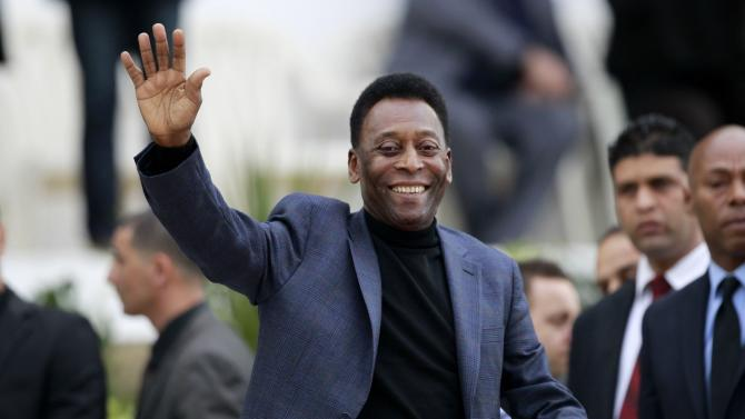 Brazilian soccer legend Pele waves during the international friendly soccer match between Algeria and Slovenia in Algiers