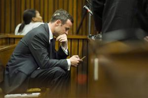 Olympic and Paralympic track star Oscar Pistorius sits in the dock during the fifth day of his trial for the murder of his girlfriend Reeva Steenkamp at the North Gauteng High Court in Pretoria