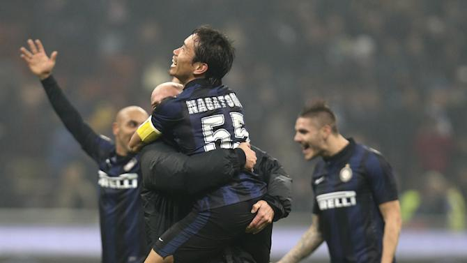 Inter Milan defender Yuto Nagatomo, top, of Japan, hugs his teammate Argentine midfielder Esteban Cambiasso at the end of the Serie A soccer match between Inter Milan and AC Milan at the San Siro stadium in Milan, Italy, Sunday, Dec. 22, 2013. A late goal from Rodrigo Palacio gave Inter Milan a 1-0 win over city rival AC Milan in an entertaining derby match in Serie A on Sunday. Palacio struck four minutes from time to send three quarters of San Siro into a frenzy