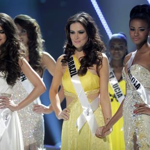 The top three finalists at the Miss Universe pageant, Miss Ukraine Olesia Stefanko, left, Miss Brazil Priscila Machado, center, and Miss Angola Leila Lopes wait for the final announcements during the pageant in Sao Paulo, Brazil, Monday, Sept. 12, 2011. Miss Brazil Priscila Machado was second runner up,  Miss Ukraine Olesia Stefanko first runner up, and Miss Angola Leila Lopes won the crown. (AP Photo/Andre Penner)