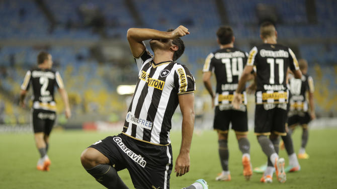 Juan Carlos Ferreyra of Brazil's Botafogo, celebrates after scoring against Ecuador's Independiente del Valle during a Copa Libertadores soccer match in Rio de Janeiro, Brazil, Tuesday, March 18, 2014
