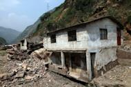 A damaged home in Yiliang. The weather is a major concern in Yiliang county. As the clouds gather above the mountain tops, the pace of the exodus appears to quicken