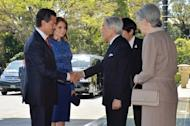 Mexico's President Enrique Pena Nieto (L), accompanied by his wife Angelica Rivera, is welcomed by Japanese Emperor Akihito and Empress Michiko upon their arrival at the Imperial Palace in Tokyo, on April 8, 2013. The Mexican leader, who arrived in Tokyo on April 7 as part of his Asian tour aimed at deepening economic ties with Tokyo and Beijing, was expected to later meet with PMShinzo Abe