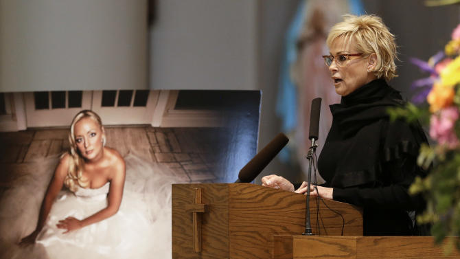 Lorrie Morgan speaks during a memorial service for fellow country singer Mindy McCready on Wednesday, March 6, 2013, in Nashville, Tenn. McCready committed suicide Feb. 17 in Heber Springs, Ark. Old friends and family members spoke about her difficulties and triumphs during the hour-long remembrance at the Cathedral of the Incarnation. (AP Photo/Mark Humphrey)