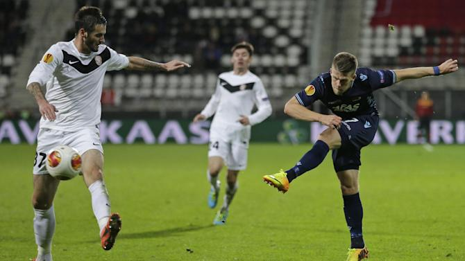 Lamela steers Tottenham through in Europa League