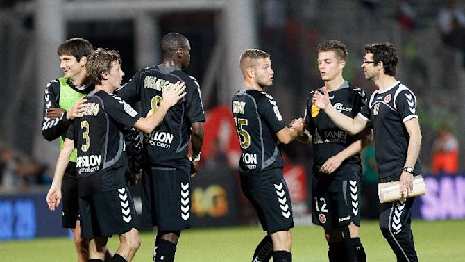 Stade de Reims players celebrate after defeating Marseille during their League One soccer match, at the Velodrome Stadium, in Marseille, southern France, Saturday, Oct. 26, 2013